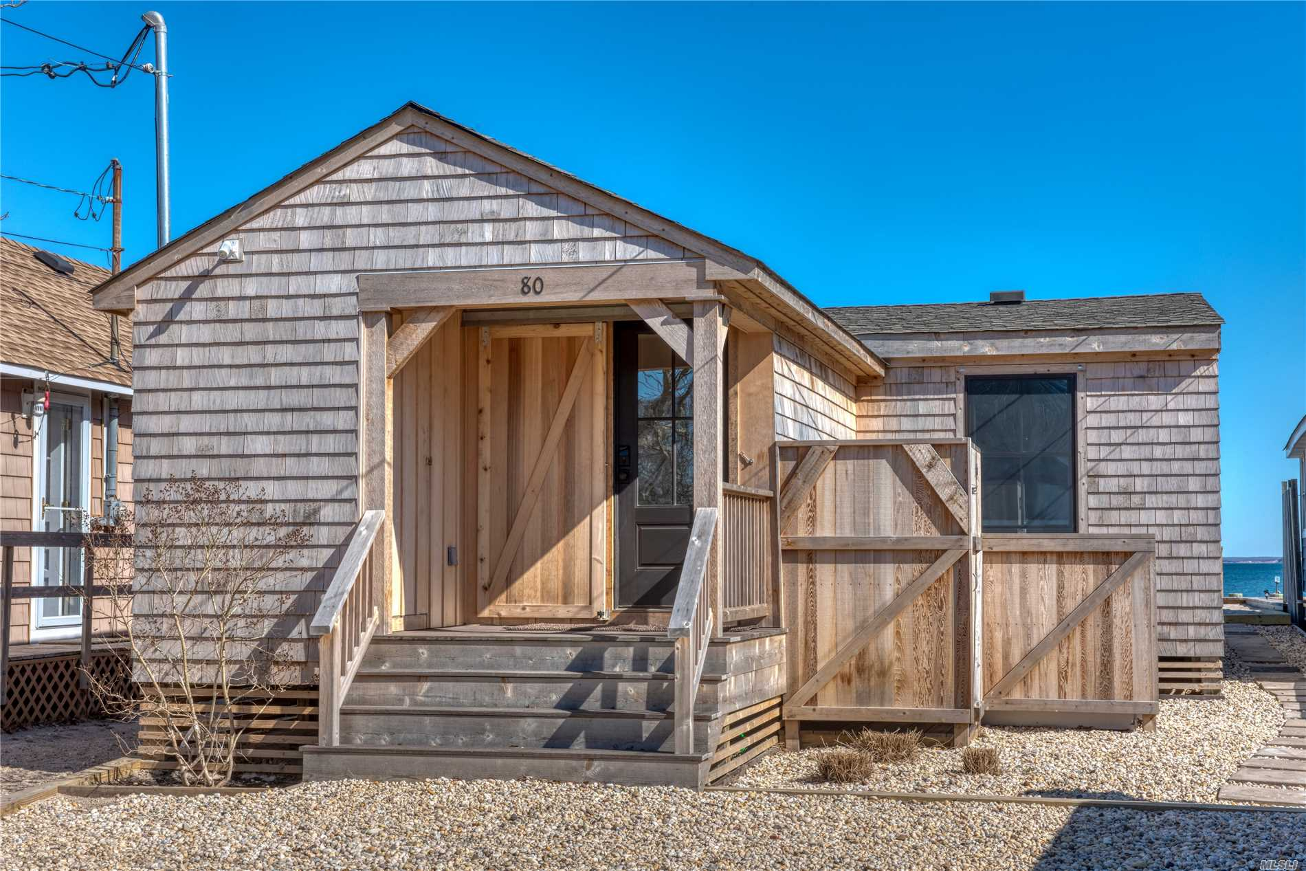Charming Rebuilt cottage with sweeping views of Peconic Bay. Features include an open floor plan for easy entertaining.. Vaulted ceilings with exposed beams. Custom kitchen. All common areas and master bedroom have water views.Sliding barn doors on all bedroom Windows to guarantee privacy and keep out the light for those lazy mornings. Open the slider and take your coffee out to the seaside deck or put your toes in the soft sand. A minute away Greenport restaurants abound.