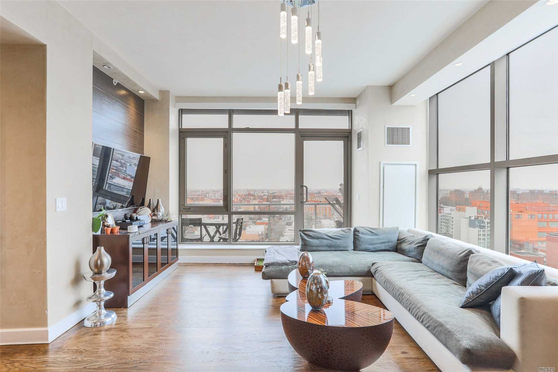 Gorgeous Two Bedroom Unit W/ A Balcony & 3 Parking Spots. Amenities Include Full-Time Doorman, Fitness Center, Landscaped Courtyard W/ Grilling Area, Bike Rack & Garage Parking. Steps From The New Ferry W/ Stops To Manhattan & Brooklyn. Walking Distance To Socrates Sculpture Park, Astoria Park, Noguchi Museum, & Costco. Unit Features A Gorgeous Kitchen W/ Stainless Steel Appliances, Hardwood Floors, Washer/Dryer In The Unit, Central Air & Heating, And A Balcony. Tax Abatement Until 2025