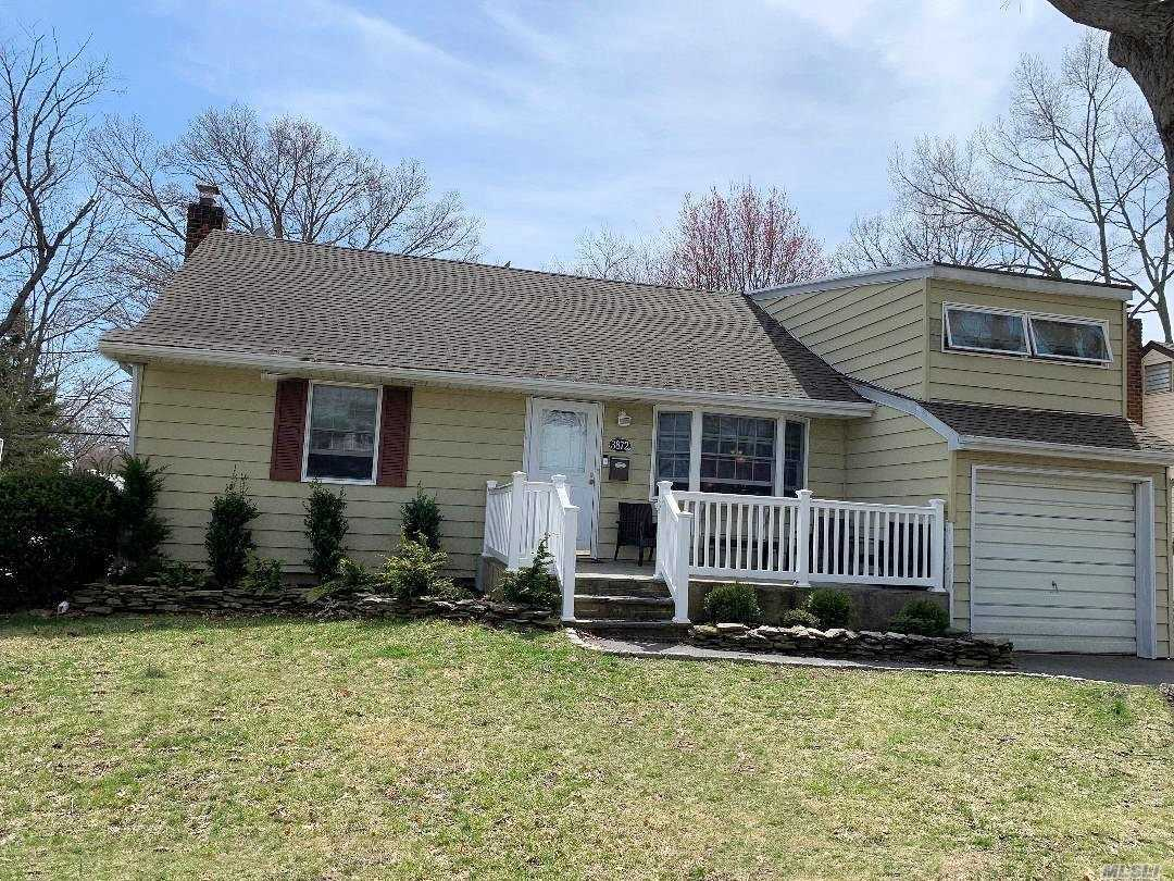 Expanded Ranch. Front porch. Open and airy.. Hardwood floors.. Extended Family room with cathedral ceilings and fireplace. Finished attic with extra playroom and walk-in closet. Finished basement. New Gas heat system. New HW Heater. New 200 electric Amp.