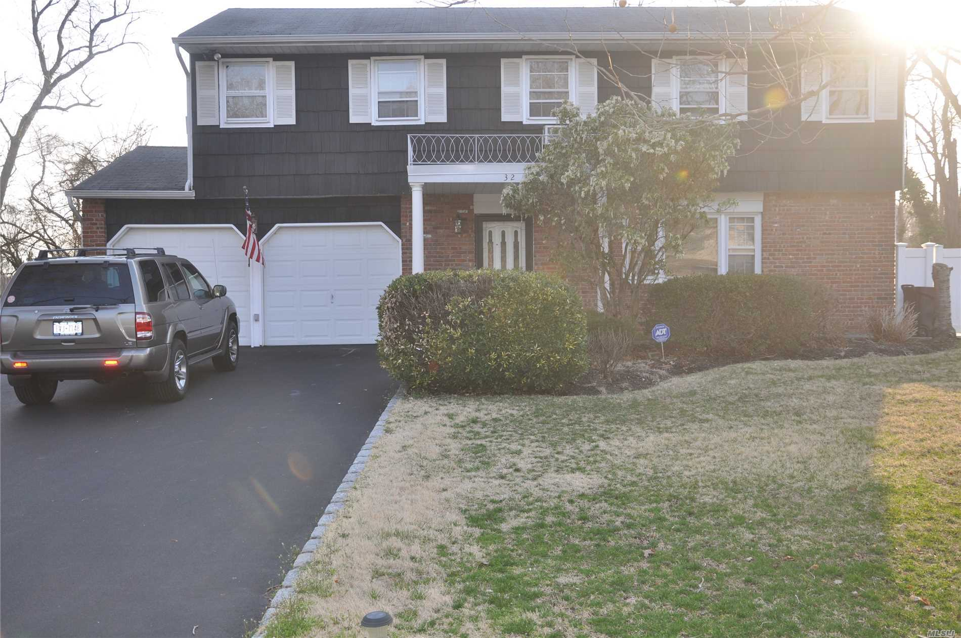 Split level on corner with very spacious rooms. Four bedrooms, Hardwood Floors, Two & Half Bathrooms, Family Room, Den, EIK, Dining Room, Living Room