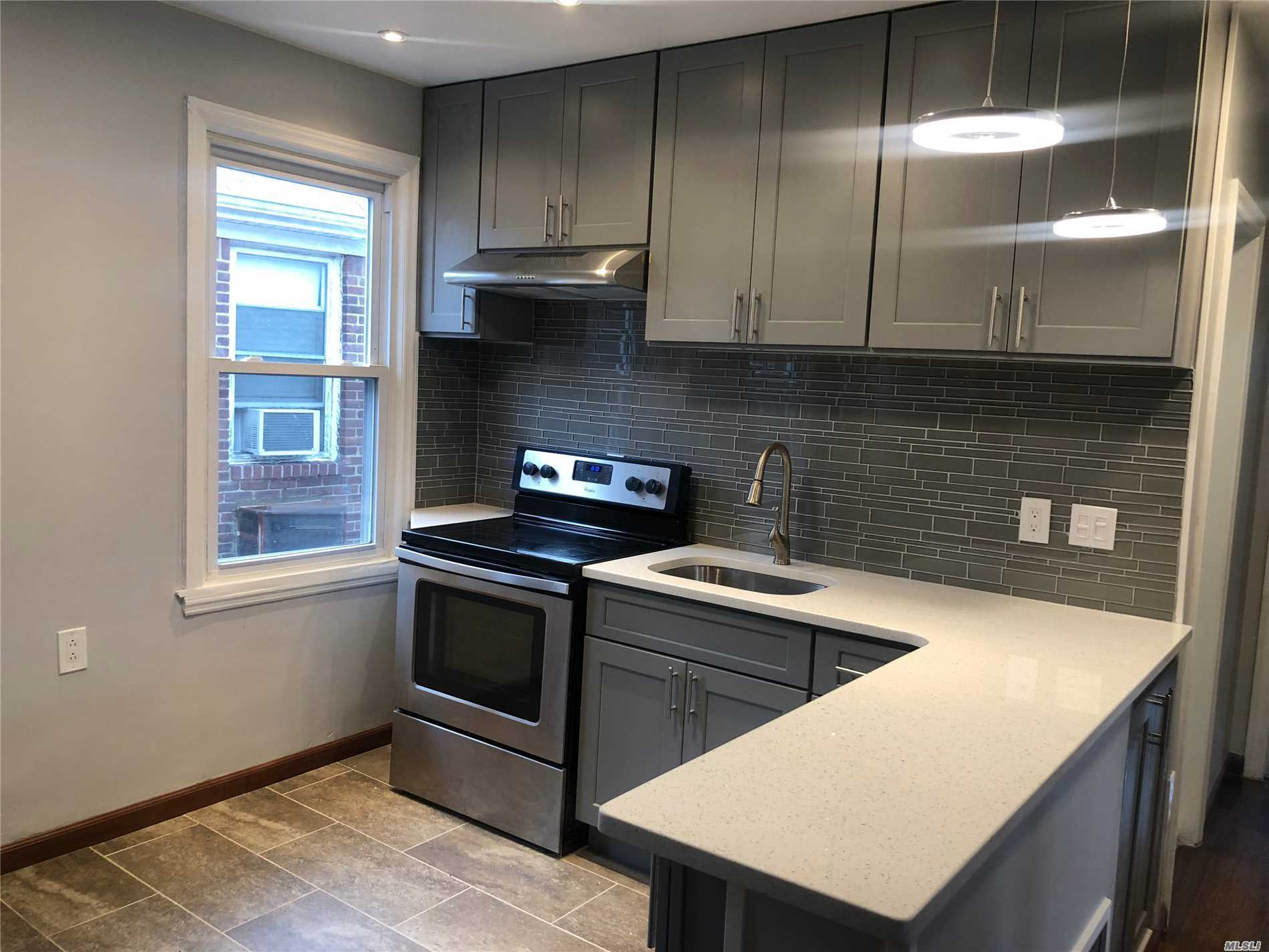 Welcome to this Beautifully & completely renovated 2 Bedroom apartment in in the exclusive Crescent section of Rego Park. Modern kitchen w/ new cabinets and stunning granite countertop along with stainless steel appliances. New wall to wall tiled bathroom. Plenty of storage/closets. New flooring throughout. Huge Balcony included. Close to many bus lines on Woodhaven Blvd and 15 minute walk to 63rd Dr & 67th Ave subway station. Steps to P.S. 174 & playground! plenty of off street parking.