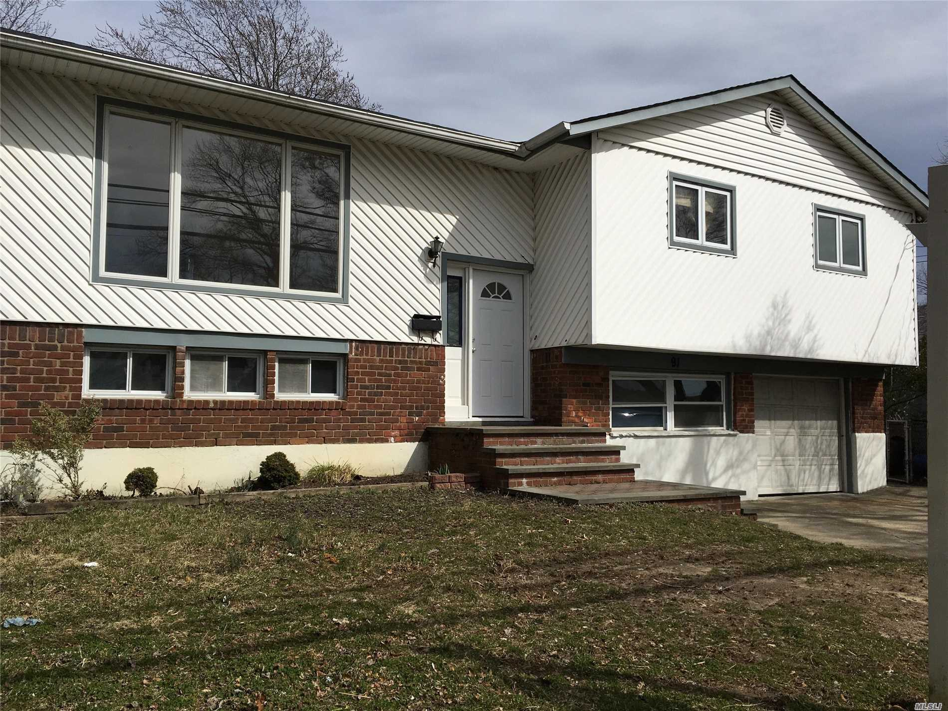 This newly renovated hi-ranch has 4 bds 2 ba, 2 new kitchens, new floors and new roof. It's easy to reach southern state parkway or sunrise hwy, walking distance to Westfield sunrise shopping mall, 1 hour to city ,  LIRR is a mile away, access from montauk to New York City, flood zone X. Property taxes grievance has been on process. Just add little final touch to make this large house into your sweet home. I know a private lender can provide 100% fund with 5% interest rate without credit check.