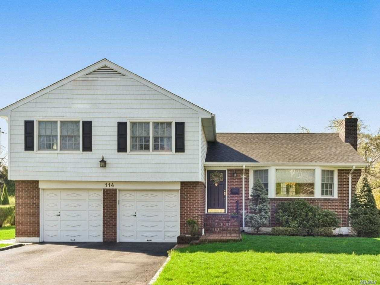 Large custom built split on large property. Mint and move in condition with numerous updates. CAC, IGS, Alarmed. Updated kitchen, baths, roof (6 years old) , new hot water tank. Wood floors throughout and new detailed moldings. Custom Closets. All new Anderson/Pella windows. A must see!