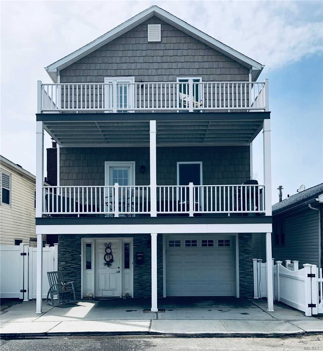 Whole House Rental in the West End of Long Beach, NY. Beach Side Living Home Offers Proximity to Beach, Completely Updated, and Parking for Up to 4 Cars! Ground Floor: Garage and Office Space. 1st Floor: Eat in Kitchen with Stainless Steel Appliances, Formal Dining Room, Bedroom, Powder Room, and Deck w/ Weber Propane Grill. 2nd Floor: Master Bedroom w/ Bathroom, 2 Bedrooms, Bathroom and Deck. Washer and Dryer, Central Air Conditioning. Wide Block. Steps to Beach, Restaurants, Boutiques, & More!