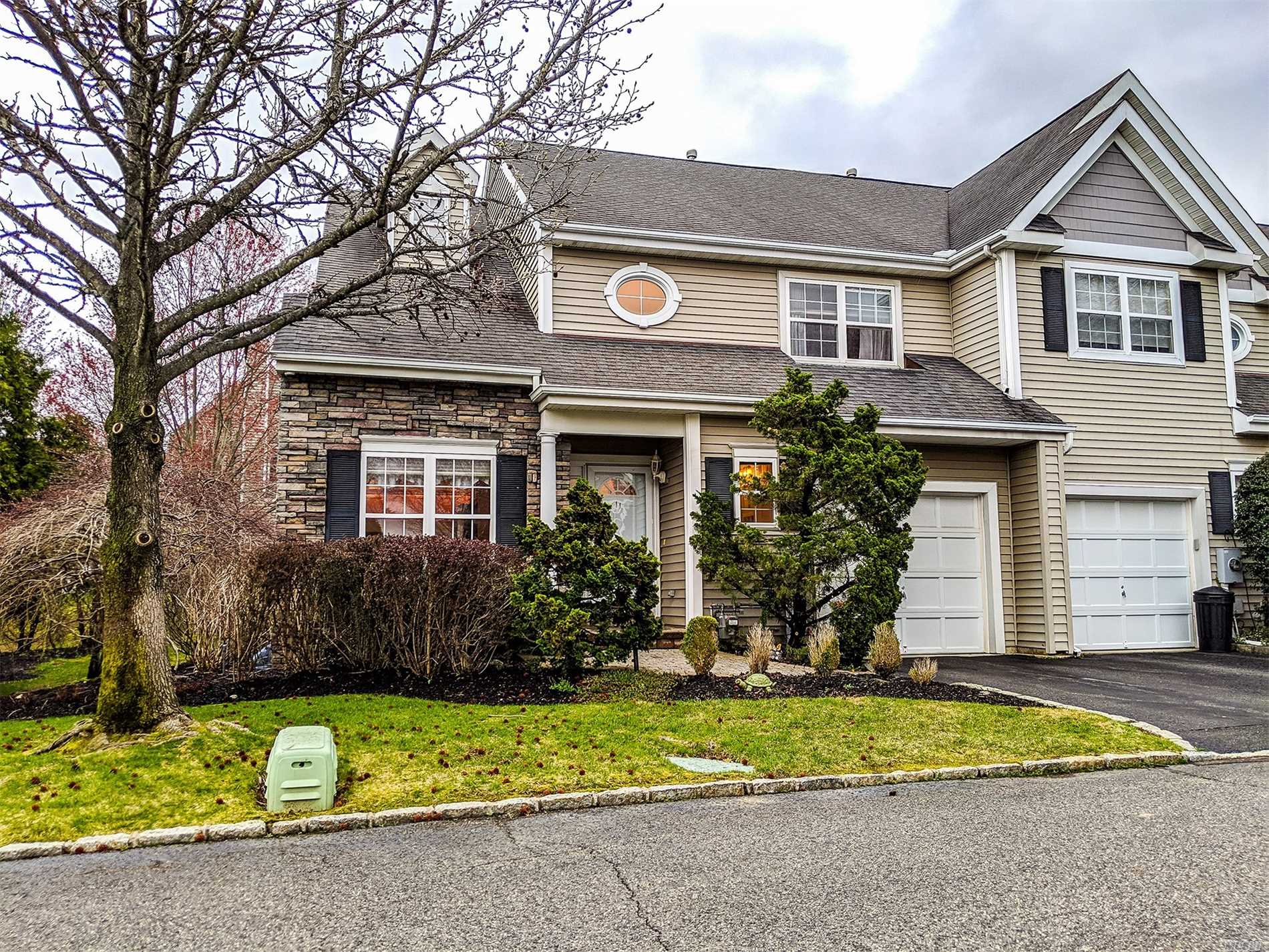 Fall in Love with this Rare find in the Windcrest Community in Smithtown. This 3 Bedroom 2.5 Bath Concord Model is an End Unit that features a Master Bedroom w/ Full Bath En-Suite on the first floor, a Large Kitchen w/ Granite Countertops and Stainless Steel Appliances, Formal Dining, Large Living Room/Den w/ Fireplace, 2 Bedrooms & a Full Bath Upstairs w/ an Additional Bonus Room which can also be used as a Bedroom. Additionally it has a Full Basement, 1 Car Attached Garage, & Outdoor Patio!