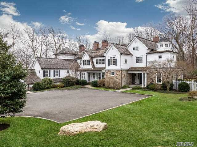 Tucked away. Beautiful Custom Colonial Built in 2009 on 5 Private Mill Neck Acres with pool and cutting garden. Fabulous Lower level with Outside Access, Full Bathroom, Family Room, Laundry, Sauna and Gym. Geotherrmal Heating. Must See!