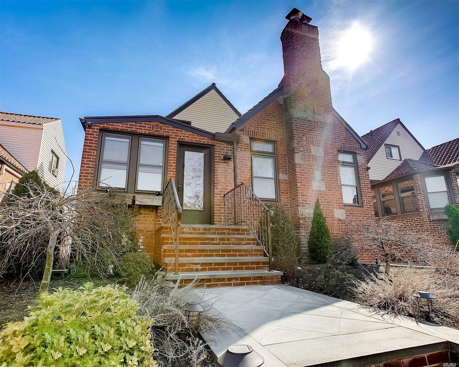 Gorgeous two family, consisting of main duplex, plus upper floor rental. Much loved, beautifully renovated and meticulously maintained. Touches of original charm and grandeur with details of stain-glass windows, 12 foot ceiling and moldings. Modern convenience of two gas fireplaces in the main living room and basement for cozy warmth and ambiance. Separate entrances to basement and upper rental; Main unit has entrance with spacious foyer. Fully paved backyard with privacy fence.