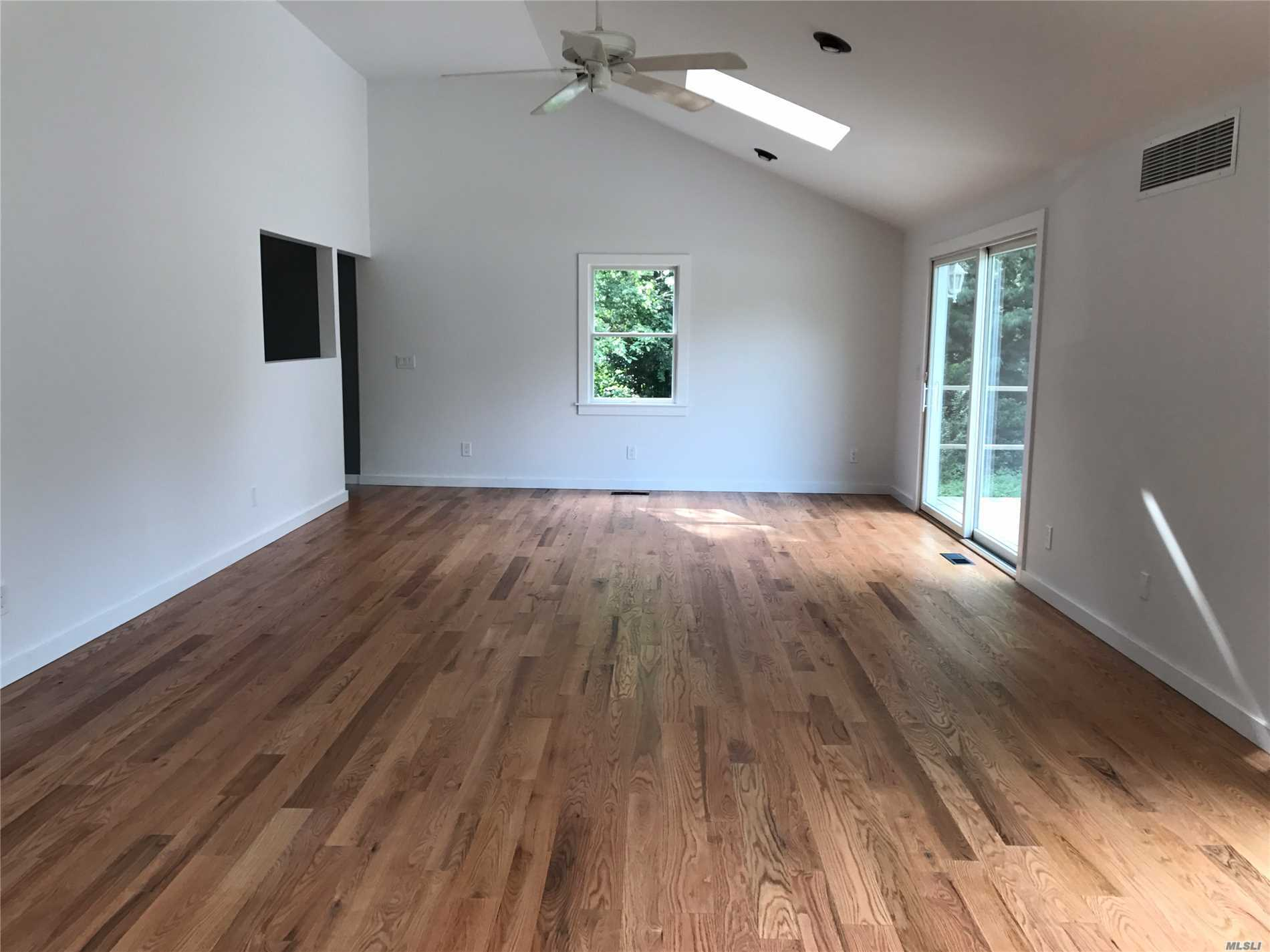 Beautiful updated expanded ranch with 4 bedrooms 2 bath, huge living room with 2 sliding doors to back deck and yard,  family room, 2 huge basements with outside entrance, brand new kitchen and appliances, hard wood floors through out the whole house. flag lot, very private with a long drive way.