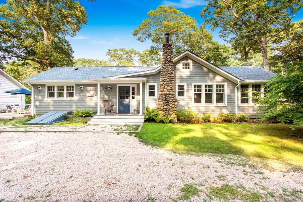 Completely renovated from top to bottom. ROW to Peconic Bay. Minutes to town for shopping, entertainment, dining and transportation.  Includes recently renovated studio guest quarters. Will consider a dog with additional pet deposit.