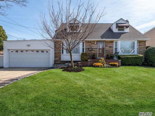 This is a 5 bedroom dormered home located in the East Williston School district with a total of 2.5 baths-featuring a large kitchen with a den/formal living room, full basement with an outside entrance leading into a two car garage, gas heat, inground sprinklers, a must see!!!!