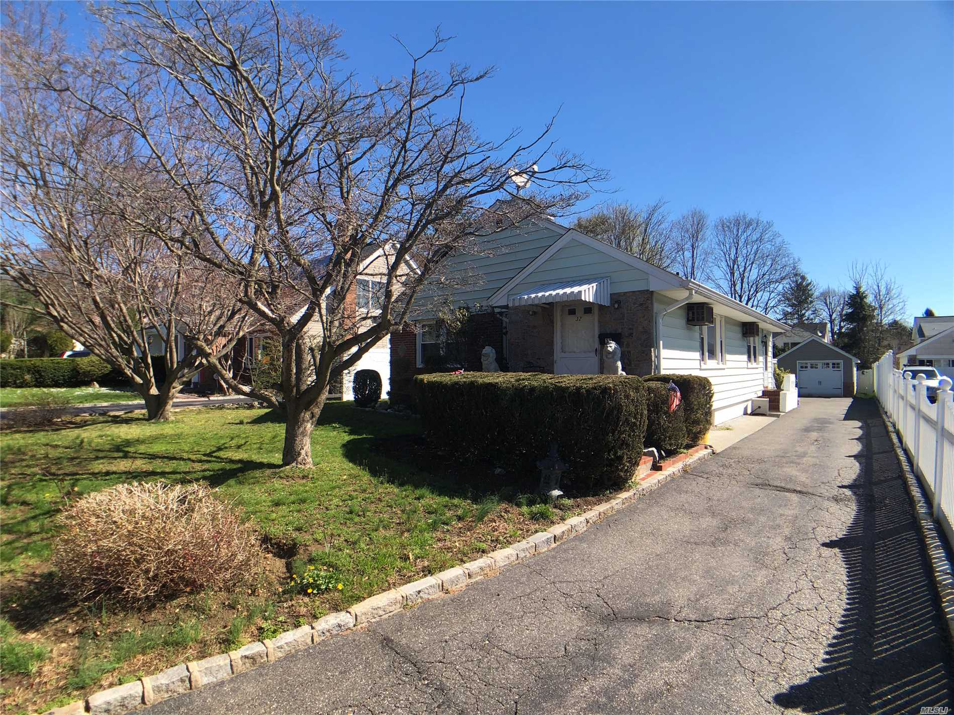 Charming home in Locust Valley, Quiet Tree Lined Street. Close to shopping, dining and attractions. Great Starter home with ability to make your own.