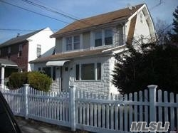 Prime Location Close To All Shopping Transaction, School, walk to LIRR, buses. Great investment property. Total 5 bedrooms with 3 full baths. Must see!!!