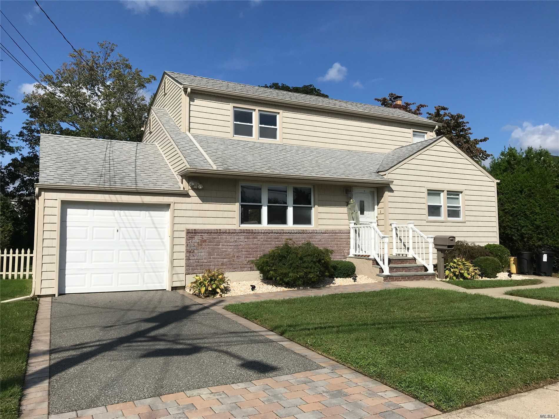 Hicksville. Mint Updated Home In The Heart Of Hicksville Close To All Major Highways, Shopping And Fine Dining. Big Fenced In Backyard. Must See.