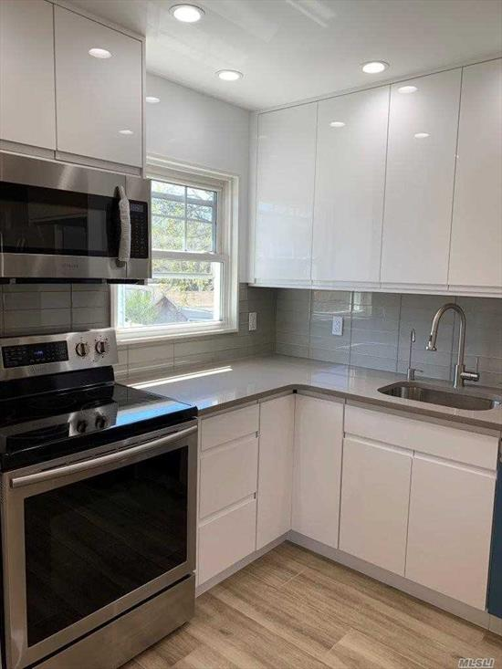 Spotless, very bright 2 bedroom apartment in the heart of Lynbrook. Everything brand new, bathroom, eat in kitchen with stainless steel appliances, custom made closets, hardwood floors, many extras. 2 parking spaces included , Close to LIRR, shopping, schools, dining, and houses of worship
