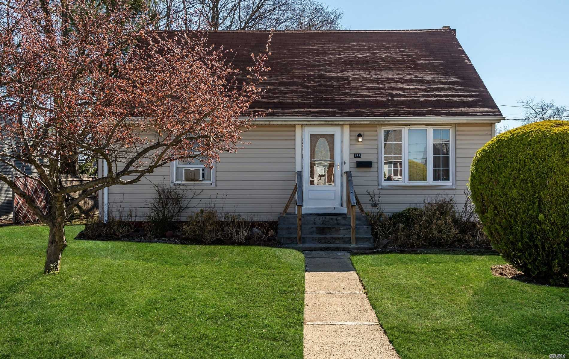 This beautiful Cape located mid-block features a formal living room, large eat-in-kitchen/dining area, 4 bedrooms, basement with laundry and storage.