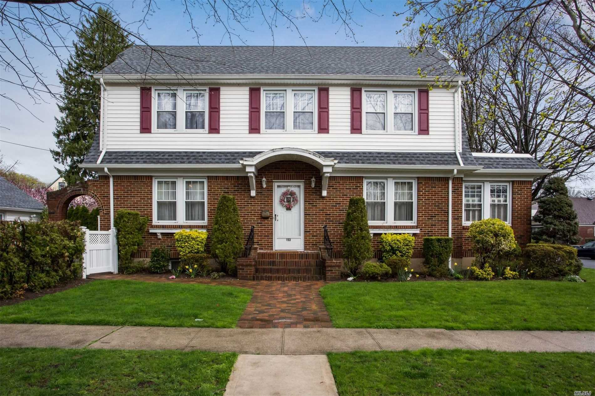 The house from Home Alone can be yours! Gorgeous CH Brick Col w/3+ bedrooms, 2 master size, oversized rooms thruout, newly renovated EIK,  Enormous LR w/fp, side den/porch, designer style full bath, full finished attic for additional living space AND fully fin basement with side door entrance,