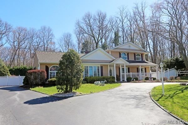 Vacation at home in this beautiful resort like back yard, total privacy surrounding the IG pool w spa , waterfall & gazebo.even a putting green, Award winning landscaping with stone retaining walls and pavers throughout .. Updated home with dark wood floors, crown moldings, 2 fireplaces spacious din Room & EIK w granite counters,  2 master suites high end bathrooms, gas heat, newer roof, Andersen windows,  charming front porch, circular driveway set in a quiet cul de sac.