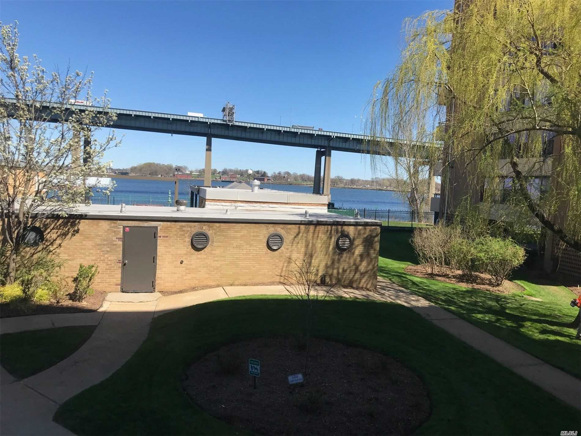 Waterfront...beautiful panoramic water and bridge views...bright and spacious...Ultra modern but dated renovations..steps to amenities..prime parking available for transfer..P121