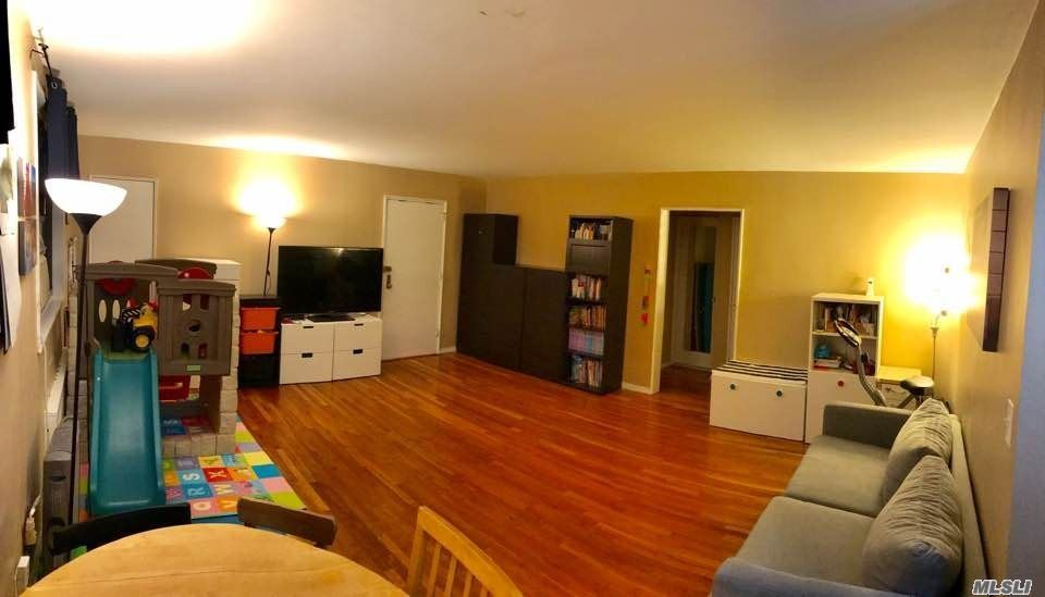 Custom Built Kitchen, Bathroom, Hardwood Floors, Convenient Location in Excellent Neighborhood, Maint. Includes Heat, Hot Water, Cooking Gas and Electric. Express Bus to NYC and Flushing: Minutes away from Bay, Bicycle path and Playgrounds.