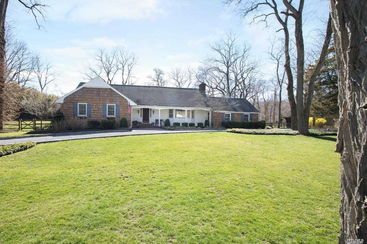 Set On Over Two Beautiful Acres Of Flat Usable Proberty And Access Into Caumsett Park. A Two Stall Barn With Running Water And Electricity For The Horse Enthusiast. This Five Bedroom Home Is Spacious, Filled With Light, Gorgeous Four Seasons Room Off The Kitchen For Year Round Living. A Fabulous Large Deck For Outdoor Entertaining. Desirable Fiddlers Green Assoc. (Dues). Beach, Mooring Rts/Dock Nearby.