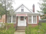 Handyman special, solid brick home in need of repairs. This house has a total of 4 bedrooms. Full basement you can finish to your own taste. Hardwood floors throughout, stainless steel appliances and a fireplace. House sits on a great tree lined street, right off Union Turnpike, which has every type of store imaginable on it. This home could also be redeveloped into a larger home(consult which engineer/architect and follow NYC DOB laws and regulations) or simply be fixed to your liking.