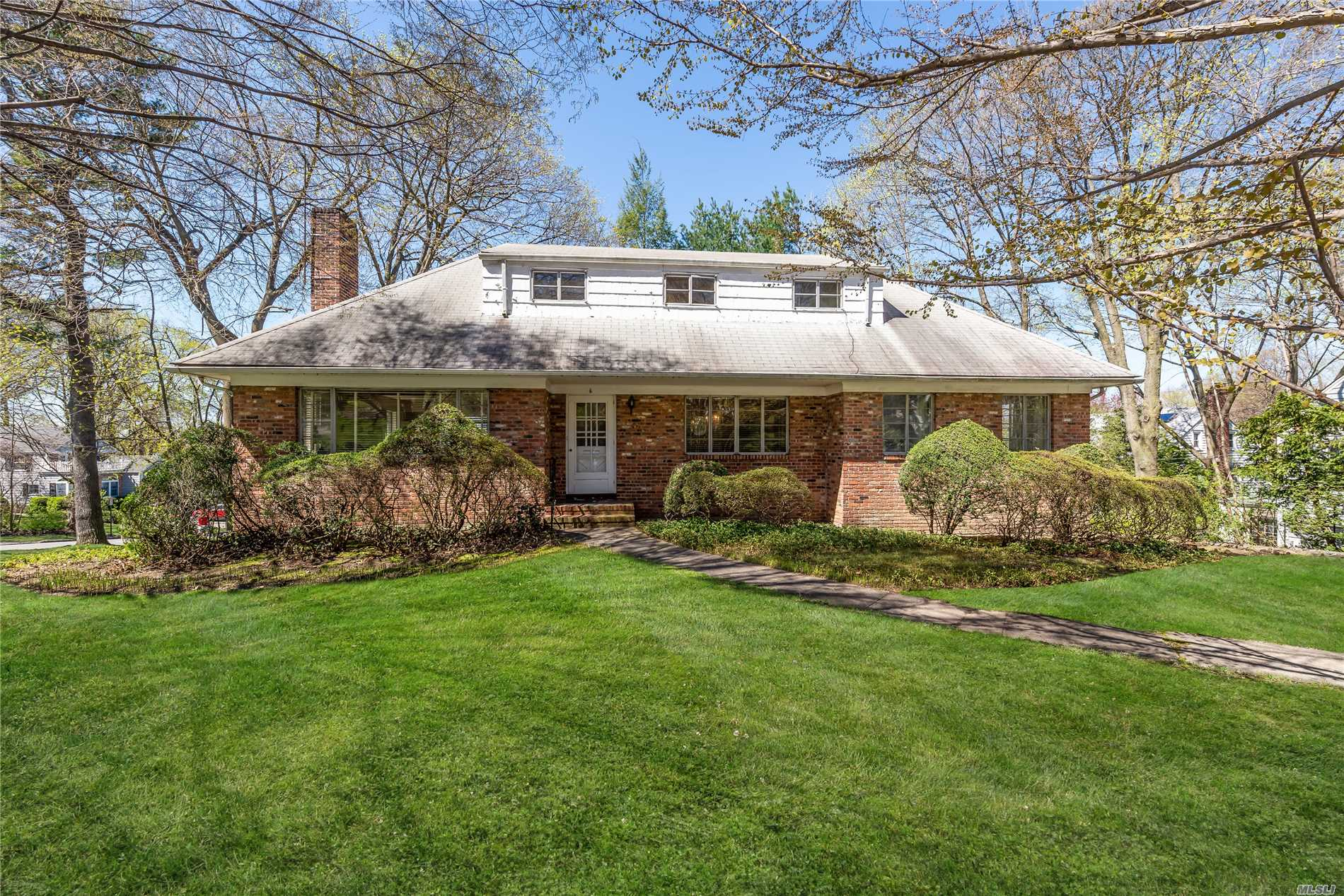 Sun drenched 4 Bedroom 2 Bath Cape in lovely neighborhood close to schools, town and LIRR awaits new owner to bring it to its full potential.