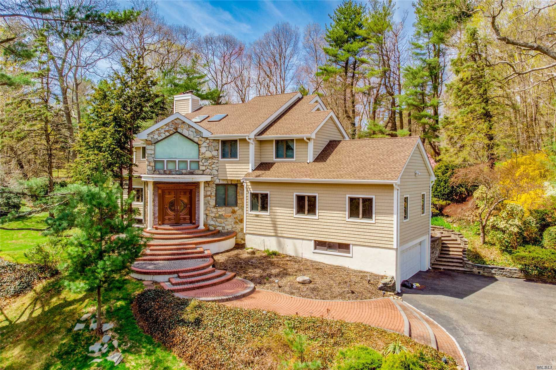 This Magnificent colonial situated very privately on 2.5 Acres Land, Cul-De- Sac, bright and airly with natural light shining throughout, 2 Master suites, Beautiful Park Surround that includes In Ground Swimming Pool and Tennis Court, Whole house Totally Renovated 2015,  The school district is Jericho School,