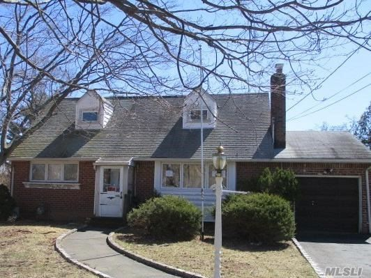 Spacious Cape with 7 rooms 4 beds and 2 bath. Commack Schools. Close to Shopping, Transportation and Major Roadways.