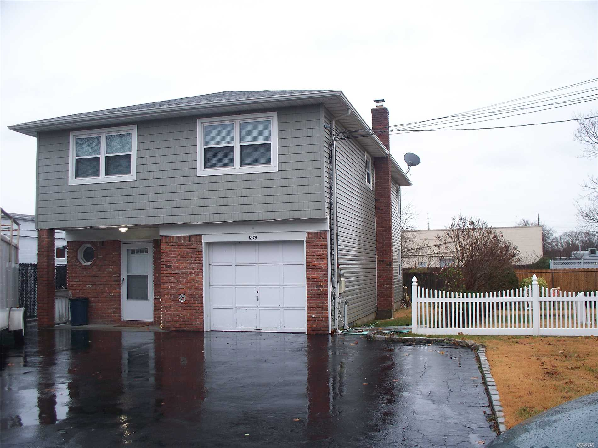 Hi Ranch on a Private Block Offering LR-FDR-Eik-4 Bedrooms-2 Full Baths-Den-Laundry-Walk to Library-Stores and LIRR