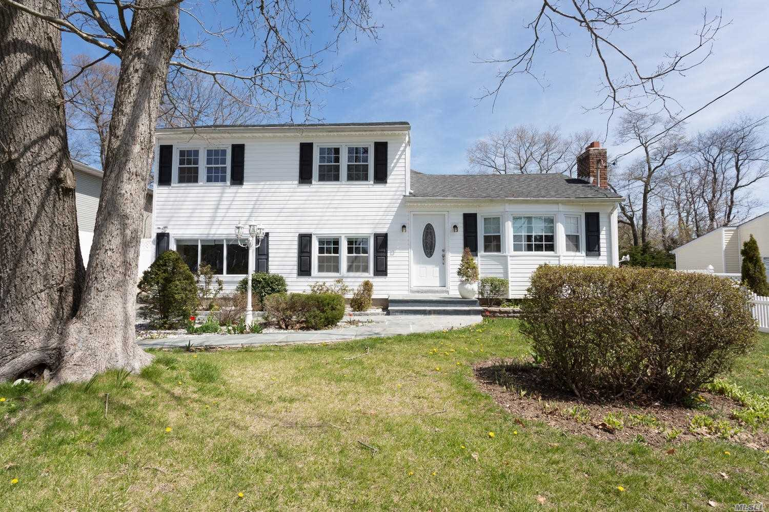 Beautiful & Pristine Home Features: 4 Bedrooms, 3 Full Baths, Large Eat-In Kitchen With Granite Counters & Stainless Steel Appliances, 3 Seasons Room, Sunken Den With Fireplace In FLR, New Electric Heating System