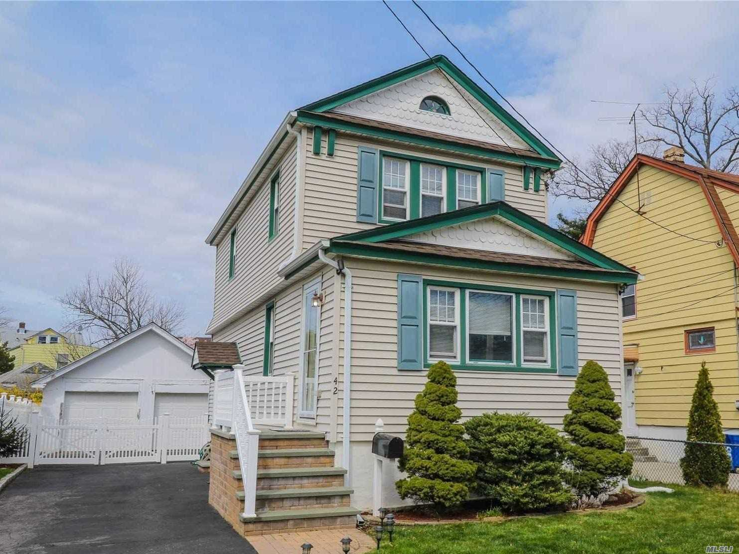 Charming 3-Bedroom Colonial Style House Offers Large Living Room, Formal Dining Room, Hardwood Floors, Full Basement With Outside Entrance, 2-Car Garage, Beautiful Patio With All New Fence, 5-Year Old Roof, Boiler and Water Tank. Close To Train Station (5 Min Walk), Restaurants, Stores. Low Taxes!