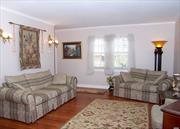 Immaculate & Charming 4Br 2Bth Exp Country Cape! Minutes To Peconic Bay. Deeded Beach Rights. Access To Southampton Beaches. Quiet & Serene Property On Dead End St. Gateway To The Hamptons! HwFlrs, Updtd Eik W/New Fridge, Huge Mbr W/2 Double Closets, All Spacious Br's. French Drs, Crown Molding, Freshly Painted, Wood Raised Panel Doors. Heated Florida Rm. Updtd Wdws/Roof/Oil Tank/Elec. Full Bsmt. Paver Patio. IGS. Lg Det 1.5 Car Gar W/Elec. Fully Fenced