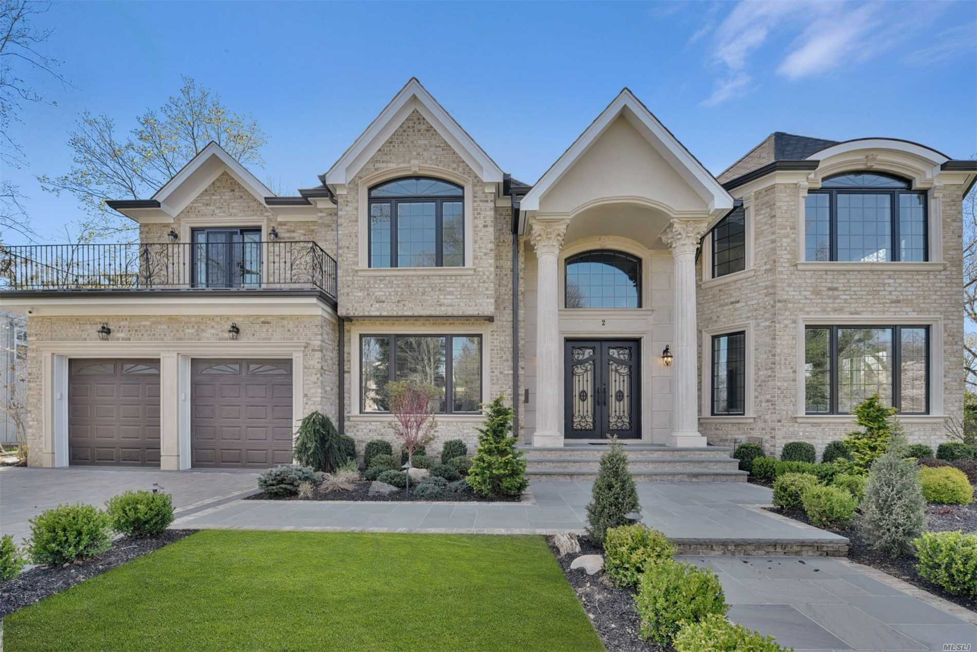 Elegant Brick Center Hall Colonial set on a magnificent, landscaped over-sized property in the heart of the Country Club section of Roslyn Heights. Radiant heat in foyer, kitchen, and all baths. Surround system, security cameras, full house generator, ready for heated driveway. Built without compromise (this is not a typical builder's home). This home reflects only the very best! Very bright home with sliding doors in the breakfast area overlooking the beautiful backyard. Must See!