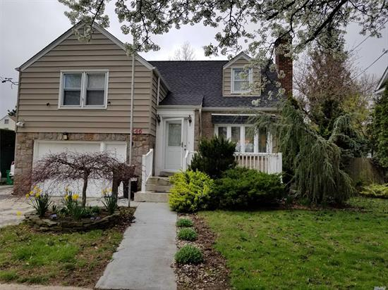 Updated Beautiful Home, Hardwood Floors, Spacious Kitchen with Stainless Steel Appliances, Granite Counter Tops & lots of cabinet space. Stylish Fire Place In Living Room. Open layout, attached Garage, nice size back yard with 2 entrances from the house. Very Convenient Location. Close To LIRR, Highways & Shopping. Hurry, Won't Last !