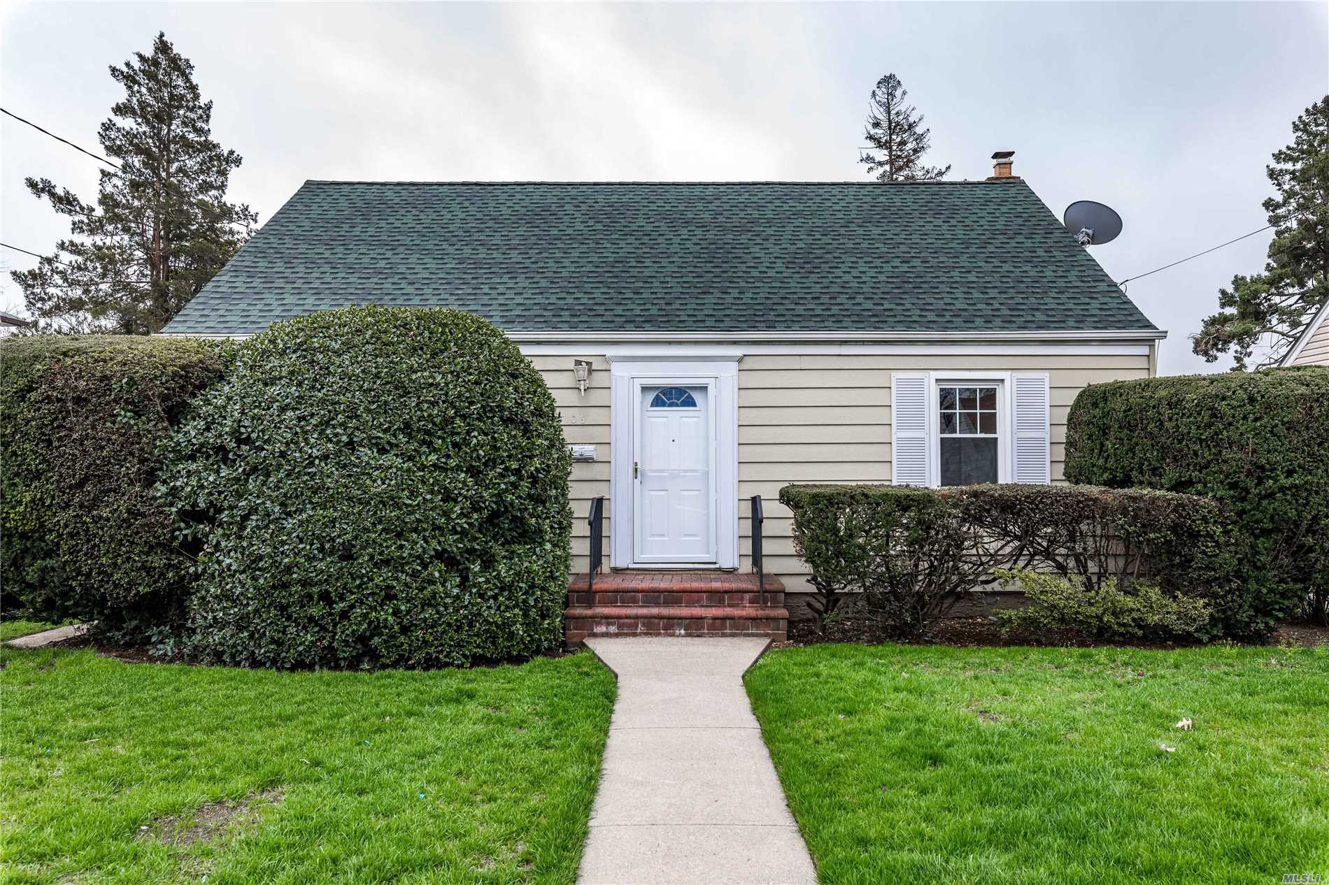 Move in ready and freshly painted! Spacious cape with hardwood floors & renovated bath. Convenient location- near shopping, Hofstra, hospitals & parkways.