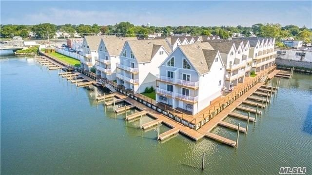 Yachtsman's Cove Is A Beautiful New Construction Waterfront Condo Development In Freeport. Featuring 3 Levels Of Living, 2 Car Garage, Private Deeded Boat Slip, Open Floor Plan W/ Hardwoods, Cac, Gas Heating & Cooking & Much More! A Wonderful Outdoor Area W/ Boardwalk, Green Space & Gazebo.