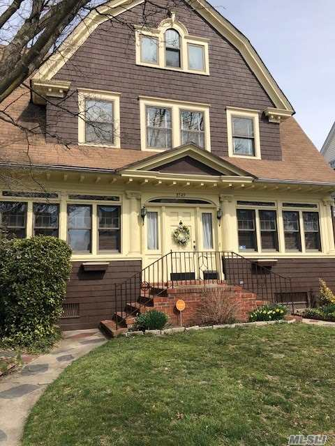 One in a Million, Restored Dutch Colonial home with new roof, cedar shingle, pvt. drive. House has 3 full levels plus finished basement. Perfect for a family who entertains w/2 fireplaces, original hardwood/parquet floors, pocketdoors, 9 stainglass windows, Enc. Full Porch with natural lighting and wainscotting ceiling, Entrance Foyer, 4 large rooms plus Eat in Kitchen and 1/2 bath on first fl. 6 bedrooms and 2 full baths on the upper floors all with hardwood floors, ample closets and storage