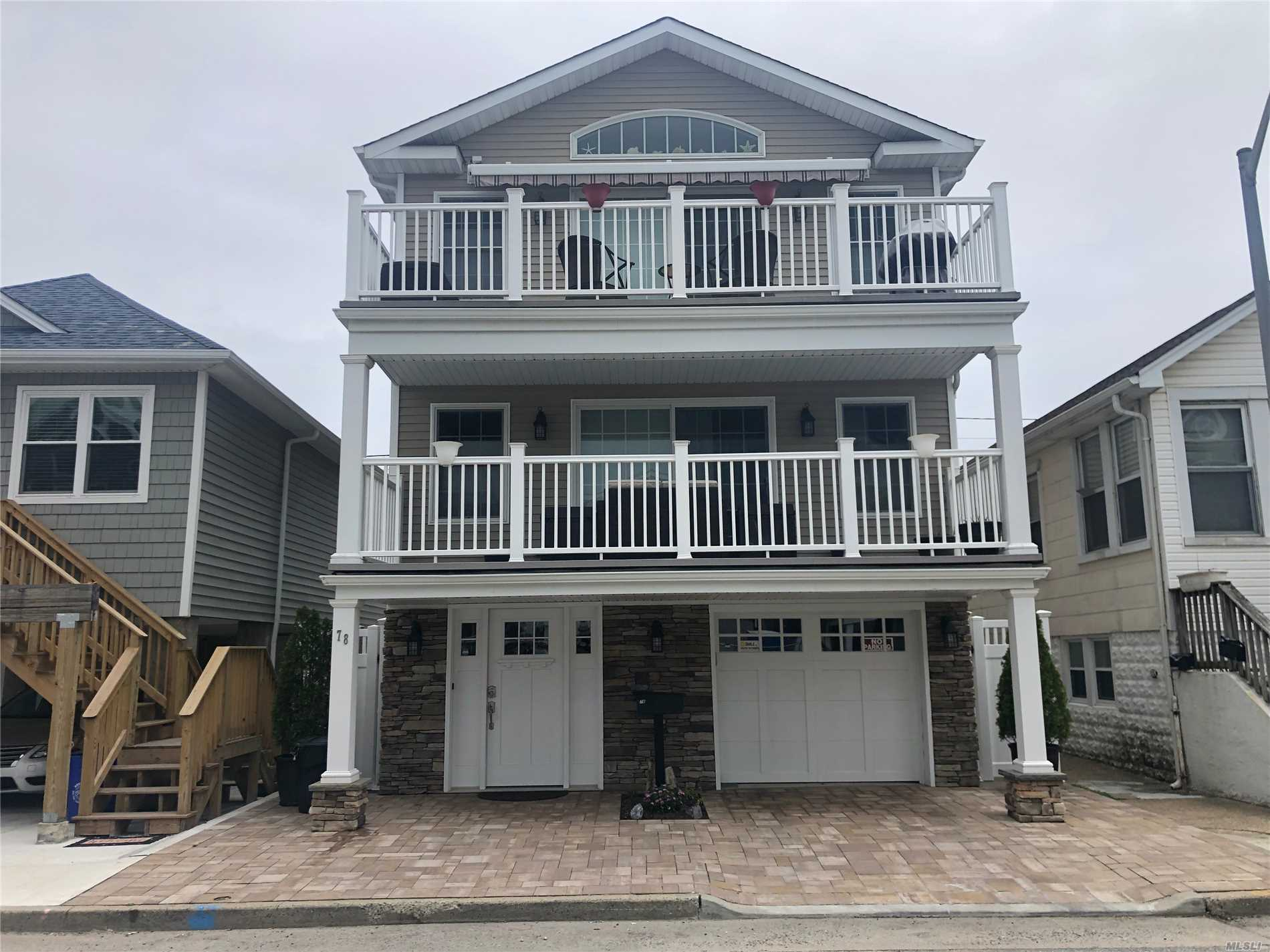Immaculate! 2013 FEMA contemporary home on wide block, in the trendy West End. Features: Grand open layout with cathedral ceiling and 8' slider leading to a large deck. Views of ocean, bay and gorgeous sunsets. Master bedroom with WIC and En Suite. Two large bedrooms with den and large storage room and 2 1/2 car garage with keyless entry. Dual zone heat and CAC, high-end appliances and fixtures, motorized awning, gorgeous oak flooring and floating stairs , Bali shades and quartz countertops.