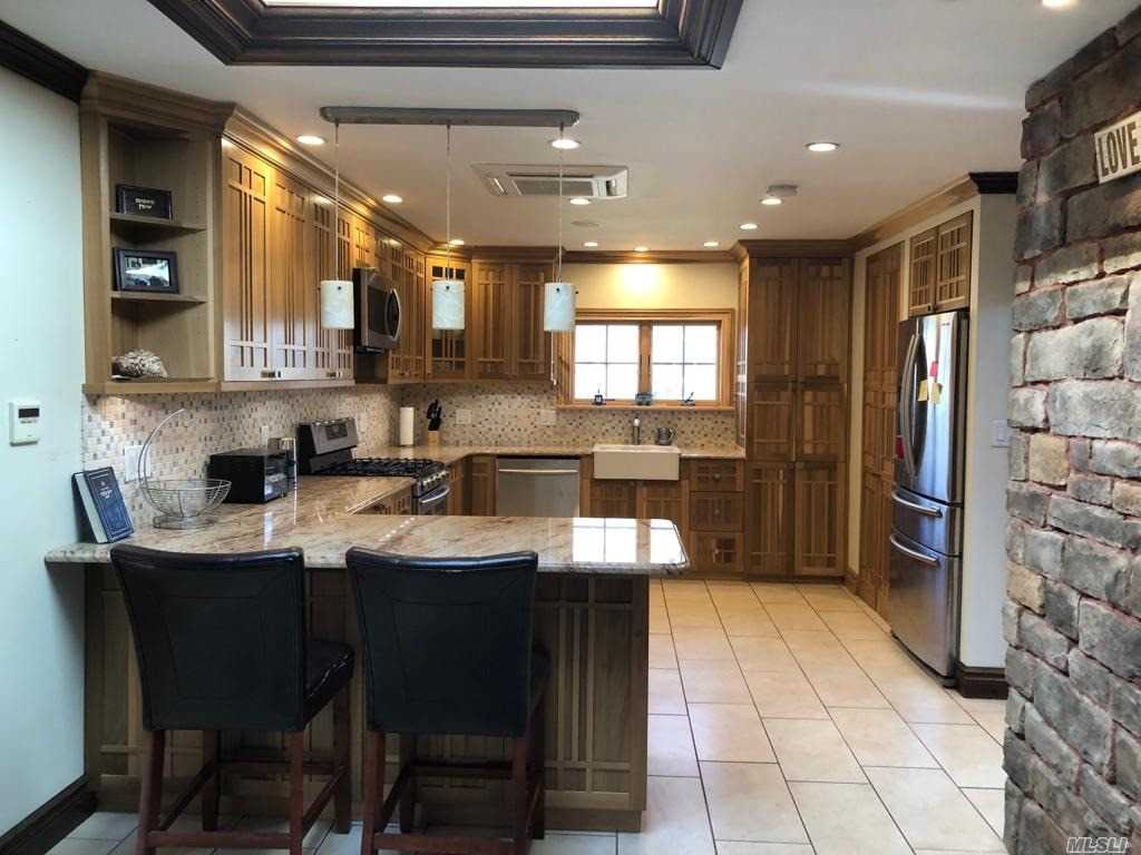 Mint Rental Home. New Kitchen, and Baths. Master Suite, 2 additional Bedrms Plus 1 Bath, Large Open Dining Room, and Family Room. Near Houses of Worship and Transportation