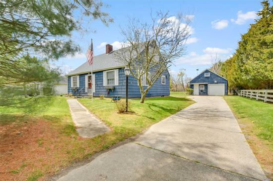 Great opportunity to live south of Montauk Highway in Remsenburg/Speonk. This two story home has great potential for the right buyer. The first floor rooms are large and spacious and with the right adjustments will be fantastic. There are two bedrooms and two unfinished rooms upstairs. There is a detached garage with second floor loft, again, with huge potential. The property is large and can easily accommodate a swimming pool.