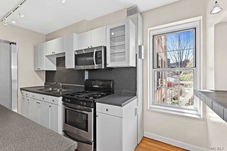 Woodside Astoria border, sunny 3BR in Boulevard Gardens features windowed kitchen with breakfast bar, wind din'g w/French doors leading to LR .Hardwood floors throughout. Located on 11+ landscaped acres with a Children's Playground & sprinkler pool, Indoor children's playroom, picnic area, multi Laundry Rooms. Bike & Personal storage avail. On site Management Office. Live in Super & Ass't Super. 2 blocks to R & M subway. 15 min to midtown Manhattan. Steps to Q-18 bus.
