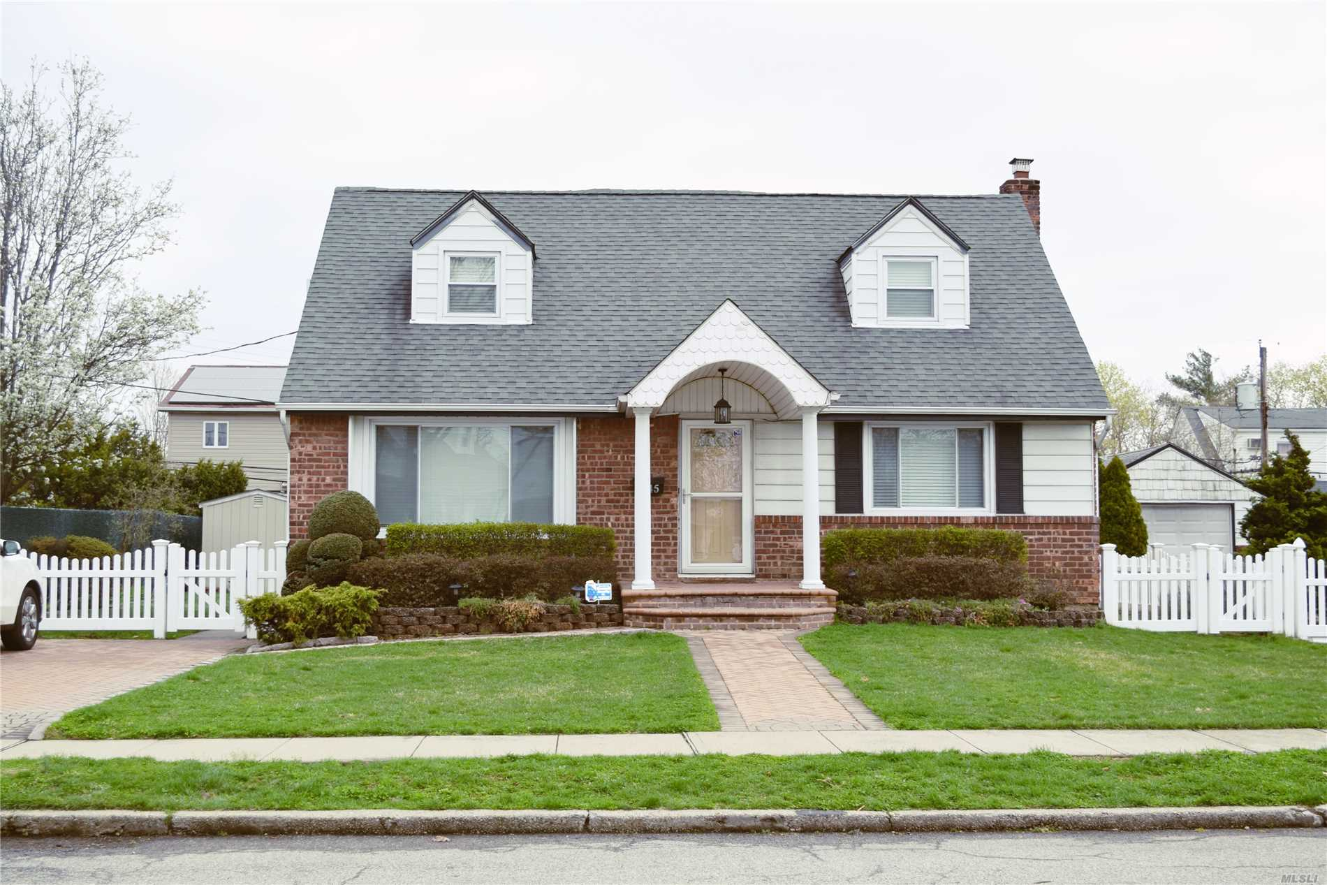 The home you've been waiting for! Beautiful, updated and clean! Gorgeous kitchen and bathrooms, Beautiful hardwood floors and solid wood doors throughout! Spacious dining, Full basement, Newer roof & burner, Excellent East Meadow SD!