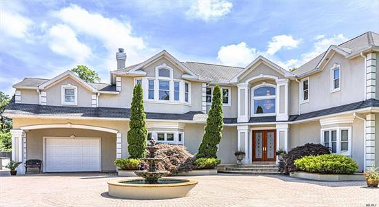 Bayberry Point, Gated 6000 Sqft Bayfront w/Assoc Beach. Overlooking the Great South Bay w/Dramatic West Coast Sunsets & Commanding Views, on a Private End Street. Grand Ent. Foyer, Open Floor Plan w/Coffered & Vaulted Ceilings Thru Out! 3Fplcs. Polished Porcelain & Radiant Heat Flooring. Office w/OSE. 20x40 Heated IGP w/Retractable Cover/Cabana Suite w/Fbth, Kit & LndryRm. Guest Quarters w/OSE - 1Brm/Kit/Living Rm.