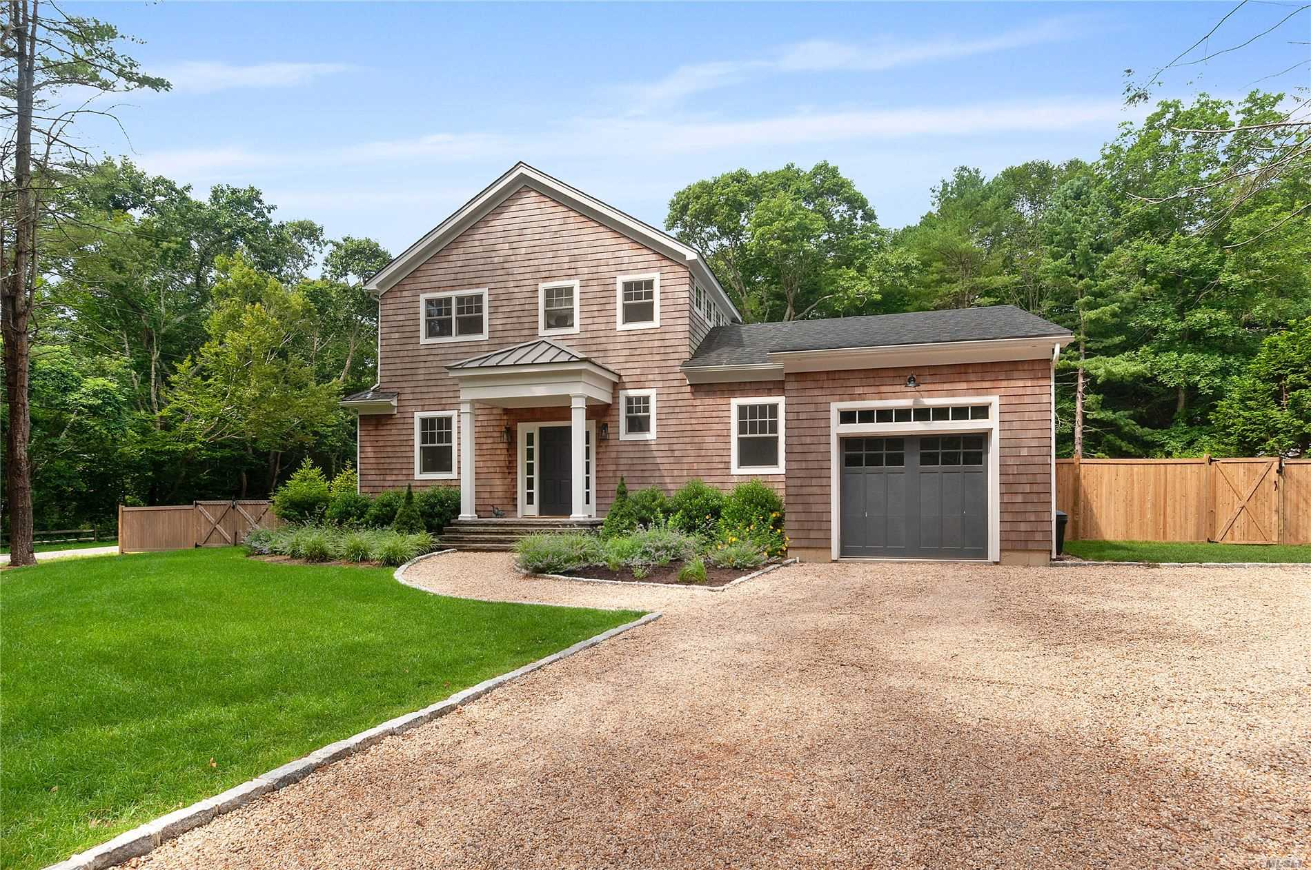 This beautifully designed new construction is just a short distance to the heart of Amagansett. Sitting on a +/-.55 acre lot this two story home has 4 bedrooms and 3.5 bathrooms, full basement, heated pool, first floor master bedroom, den, mud room and attached one car garage. In the entry and throughout the home are wide-plank hard wood floors.