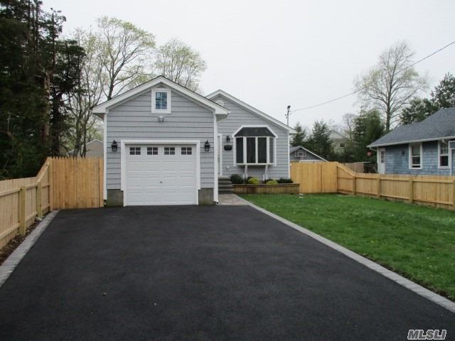 Just move right in and enjoy Babylon Village. Beautifully renovated ranch. New custom kitchen, new appliances, new baths, finished basement, wood floors throughout, New heating and central Air, 1 car garage, new driveway and fenced yard.