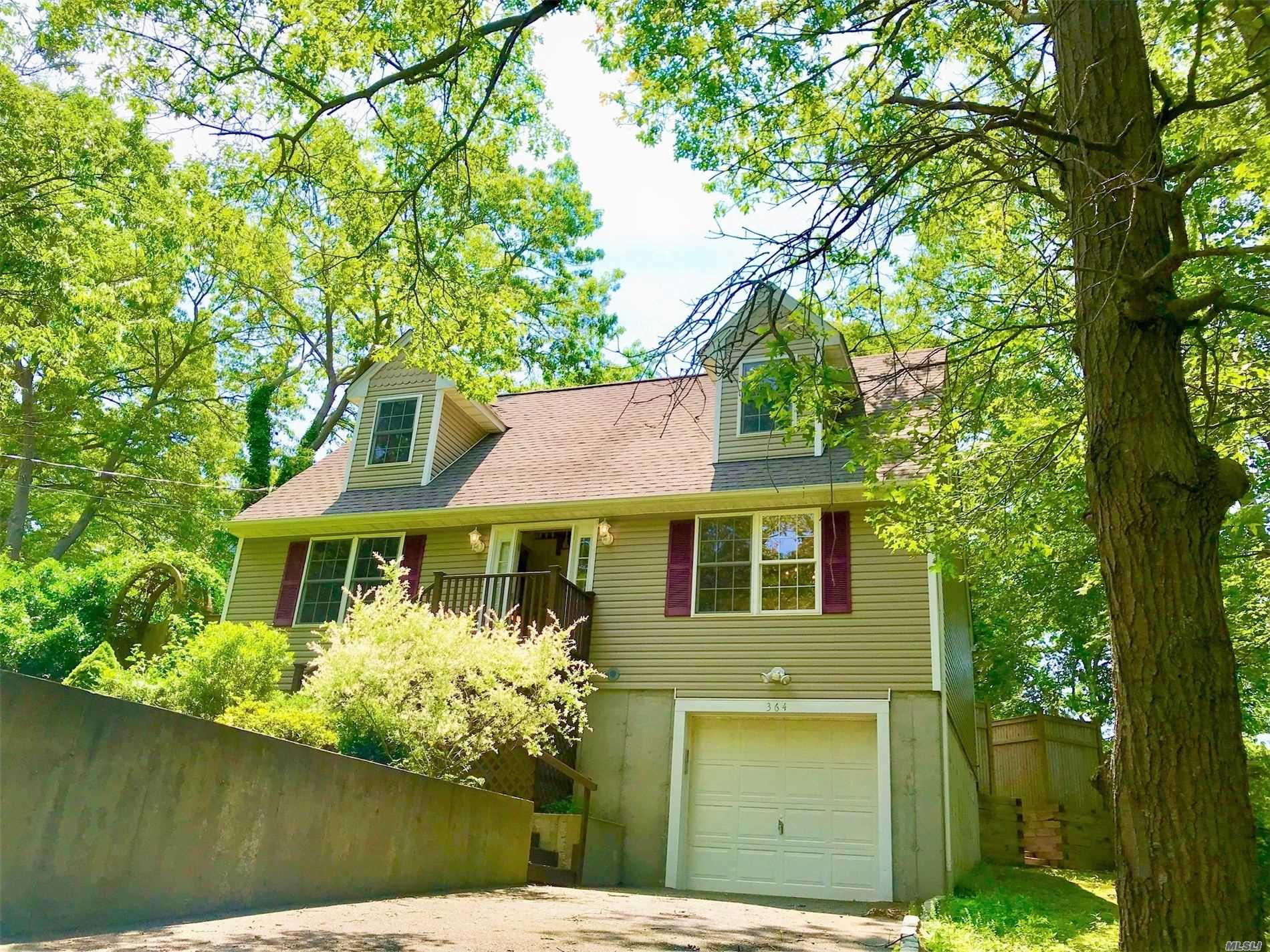 Diamond Expanded Cape W/ Open Floor Plan, 3 Bed, 2 Full Bath, I Car Garage,  Large & Updated Eat-In Kitchen W/ Granite Counter Tops W/ New Stainless-Steel Appliances, Formal Dr, Hi-Hats & Oak Hardwood Floor Throughout, Architectural Roof. Move-In Ready Home, Updated Full Finished Basement w/ Full Bathroom, Dining Room W/Slider Door To Deck W/ Fully Fenced in Back Yard, Great Location! Near Restaurants, Shopping, Just a Short Drive To Beach & Parks, Miller Place Schools!