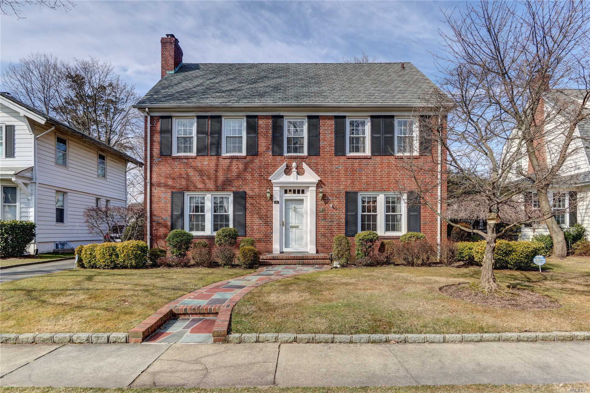 Perfectly situated mid block brick center hall colonial with oversized bedrooms, including master with suite. Set on 60x100 lot near Nassau Boulevard train this home has beautiful first floor layout with updated kitchen and adjacent family room. Charming back staircase leads to oversized 4th bedroom perfect for guest or au pair.