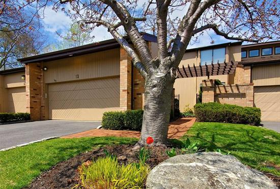 Lovely & Very Spacious Condo. Foyer, EIK, Dr & Lr w/Fpl, Vaulted Ceiling, Skylights. Master Bedroom Suite, Den w/Full Bath. Access To Garage From Laundry Area. Deck From Living Room & Bedroom. Second Level Has Loft Area w/ 2 Bedrooms & Full Bath. Huge Walk Out Lower Level w/Additional Rooms, Full Bath & Storage. Conveniently Located Near Transportation & Shops. Free shuttle to the LIRR.