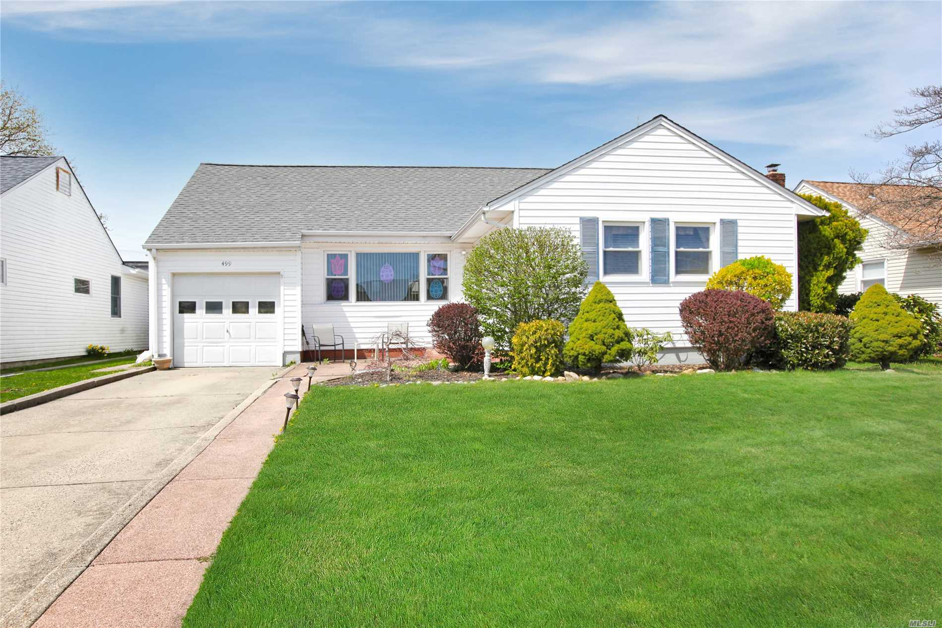 Great Ranch in Bethpage in lovely neighborhood with sidewalks and lamp posts. 3 bedroom 1 bath with full bath in basement as gift. Updated heating system. Roof/siding approx 15 years old.