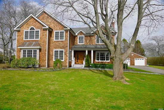 Southampton Village Traditional home on .50 acres with 4000 sf of beautiful living space. The Main floor offers living Room and separate Dining room, two wood burning fireplace, Convenient Mudroom, Guest Bedroom/ bath, Separate Pwdr Room, Home office, Gourmet Eat-in-Kitchen, Viking Appl, Custom Cabinetry and Granite Counters,  Second Floor has Master Bedroom Suite with Vaulted Ceilings, Large walk-in closet, Master Bath/Steam Shower/Tub. 4 Add Guest BRs/2 Bths, large patio, pool, detached garage.